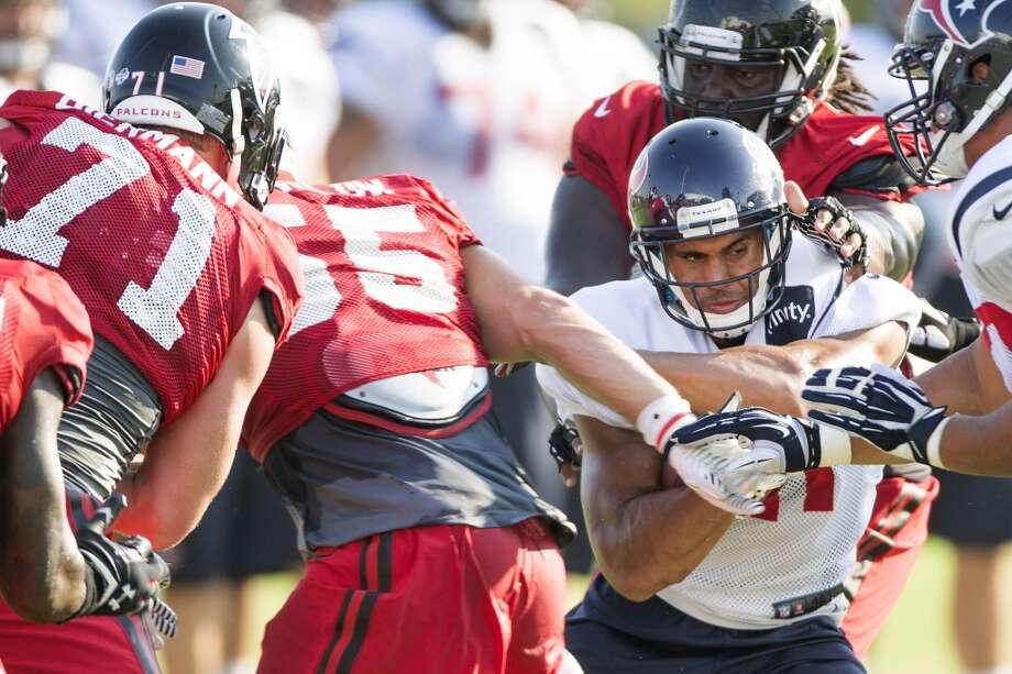 Texans running back Jonathan Grimes (41) runs the ball against the Atlanta Falcons defense. Photo: Brett Coomer, Houston Chronicle