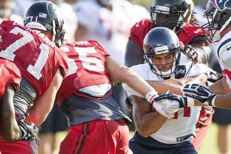 Texans running back Jonathan Grimes (41) runs the ball against the Atlanta Falcons defense.