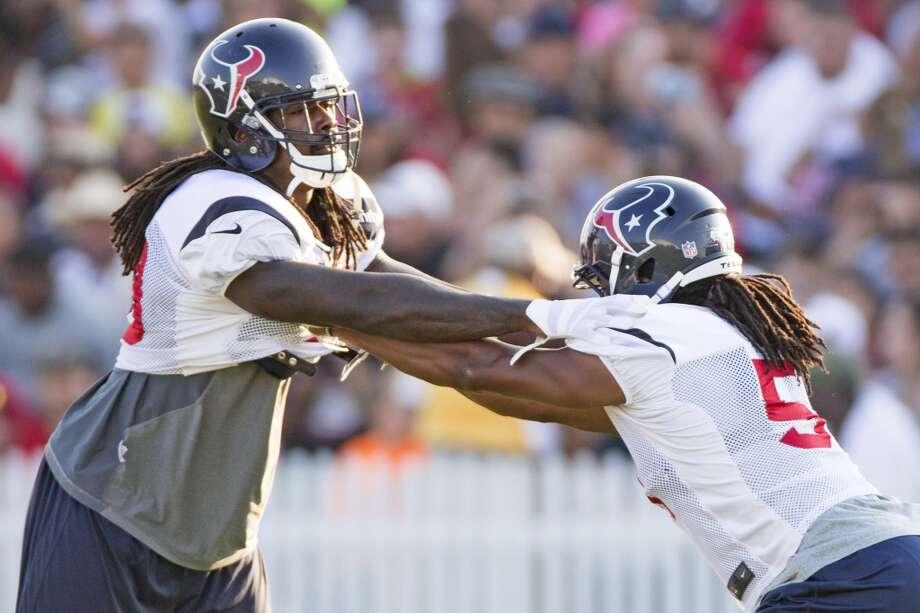 Texans linebacker Jadeveon Clowney, left, works with Texans linebacker Paul Hazel. Photo: Brett Coomer, Houston Chronicle