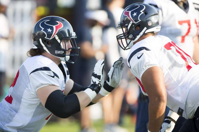 Texans tackle Brice Schwab (72) and guard Xavier Su'a-Filo (70) work on blocking drills.