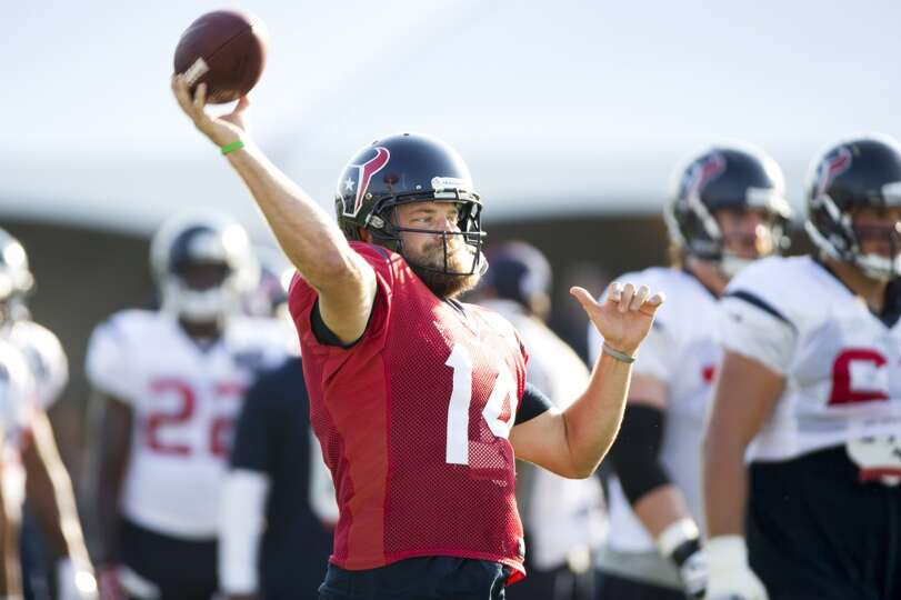 Texans quarterback Ryan Fitzpatrick (14) throws a pass.