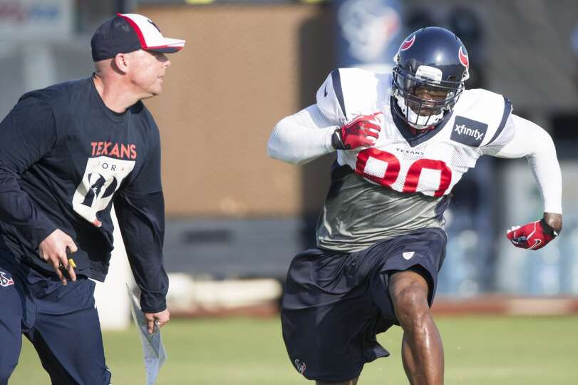 Texans wide receiver Andre Johnson (80) runs a pass route against quarterbacks coach George Godsey.