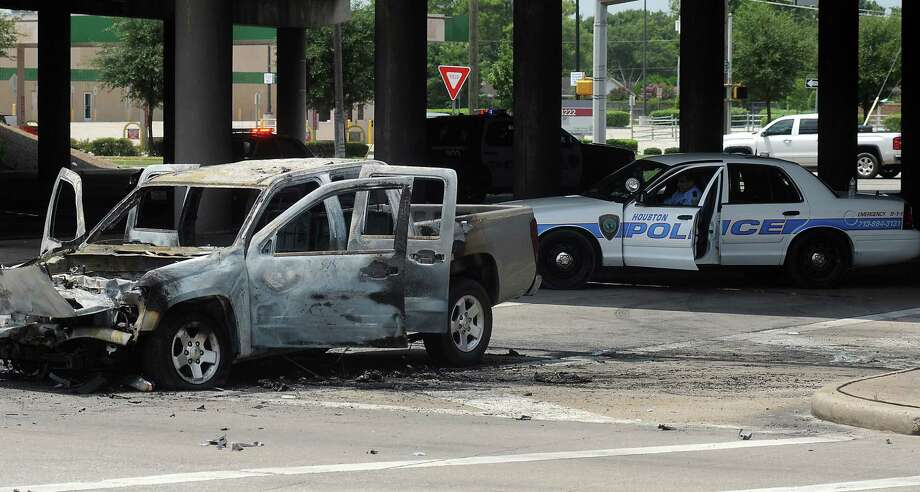 Officers work the scene of an car fire at the intersection of I-45 at Gulf Bank Thursday morning Aug. 14, 2014.(Dave Rossman photo) Photo: Dave Rossman, For The Houston Chronicle / © 2014 Dave Rossman