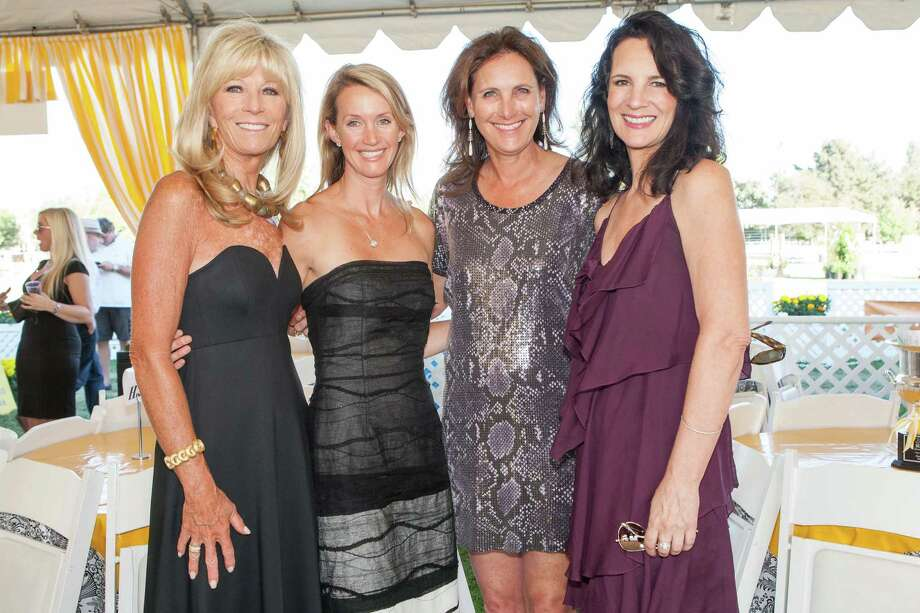 Susan Martin, Emily Foley, Suzanne Rischman and Emmy McCormack at the Menlo Charity Horse Show in Atherton on August 8, 2014. Photo: Drew Altizer Photography/SFWIRE, Drew Altizer Photography / © Drew Altizer Photography 2014
