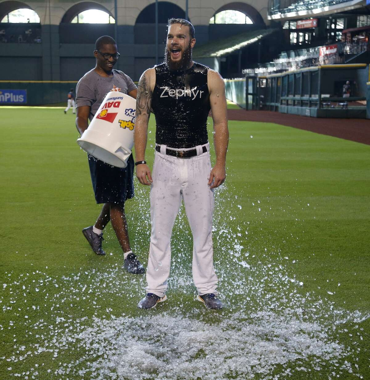 Houston Astros starting pitcher Dallas Keuchel reacts after getting dunked with ice by by strength and conditioning intern Gregory Bourn for the Ice Bucket Challenge to strike out ALS before the start of batting practice at Minute Maid Park, Tuesday, Aug. 12, 2014, in Houston. ( Karen Warren / Houston Chronicle )