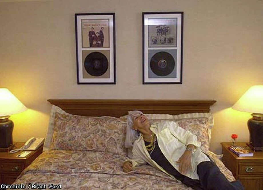 Vienna Watkins, the Cabana's original director of sales and marketing, shared memories at the suite's unveiling in 1999 of manager Brian Eptein's three-age memo detailing security measures for the Beatles. (Note: Room furnishings have been substantially updated since this photo was taken, although the framed items of memorabilia, some of them reproductions, remain.) Photo: Brant Ward, The Chronicle 1999