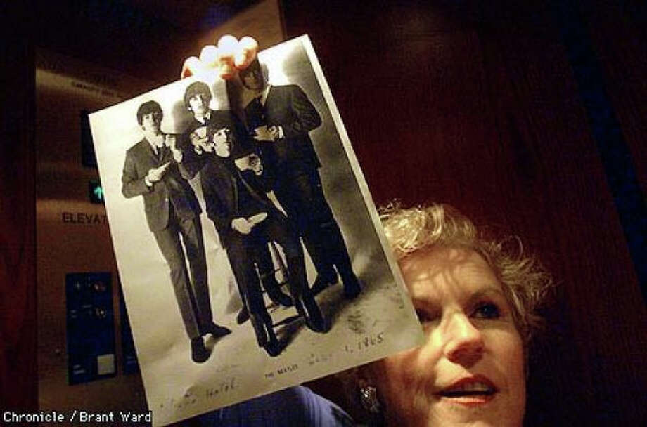 In 1999, Michele Kelly began a tour spotlighting the group's visit to the hotel by holding up a photo of the performers taken around the time of their two-day stay there in 1965. Photo: Brant Ward, The Chronicle 1999