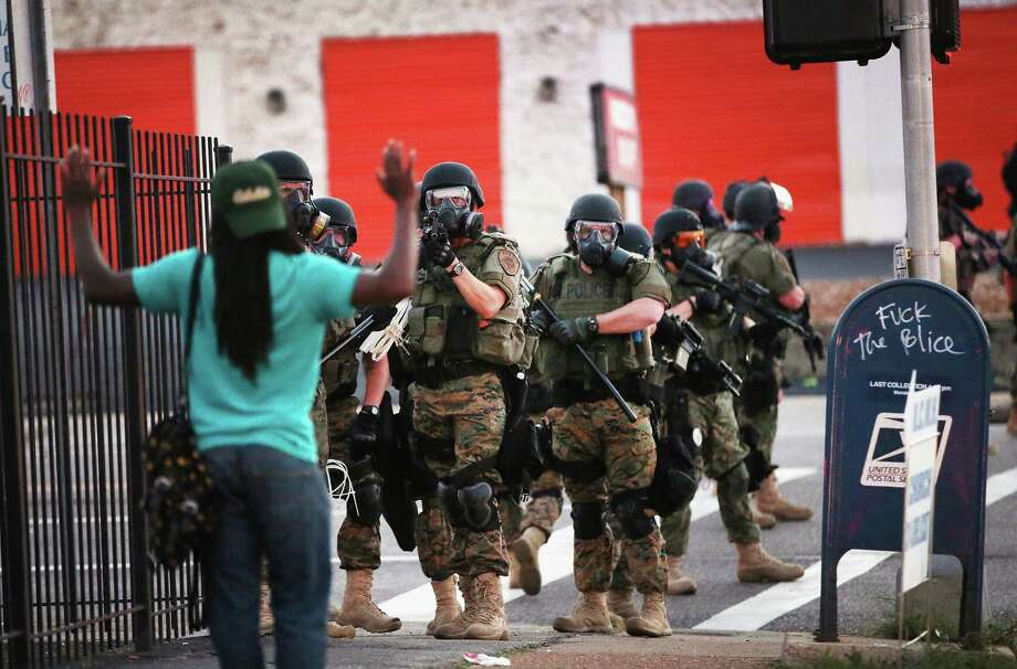 The streets of Ferguson, Missouri were home to protestors and riot police after Michael Brown, an unarmed Black teenager was shot and killed by a local police officer. With a grand jury's decision whether to prosecute Darren Wilson looming, take a look at and compare some of the local arrest rates for Black and non-Blacks around the Houston area. Photo: Scott Olson, Getty Images / 2014 Getty Images