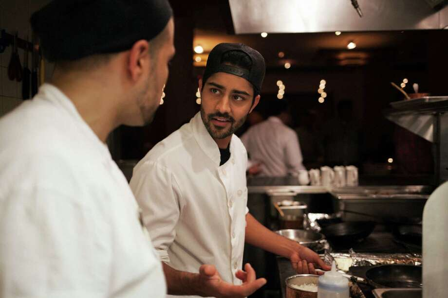 "Manish Dayal, co-star of ""The Hundred-Foot Journey,"" cooks at Junoon, an Indian restaurant in New York. His character's omelets may entrance Helen Mirren's Michelin-starred restaurateur, but Dayal does not fare so well himself. Photo: AN RONG XU, STR / NYTNS"
