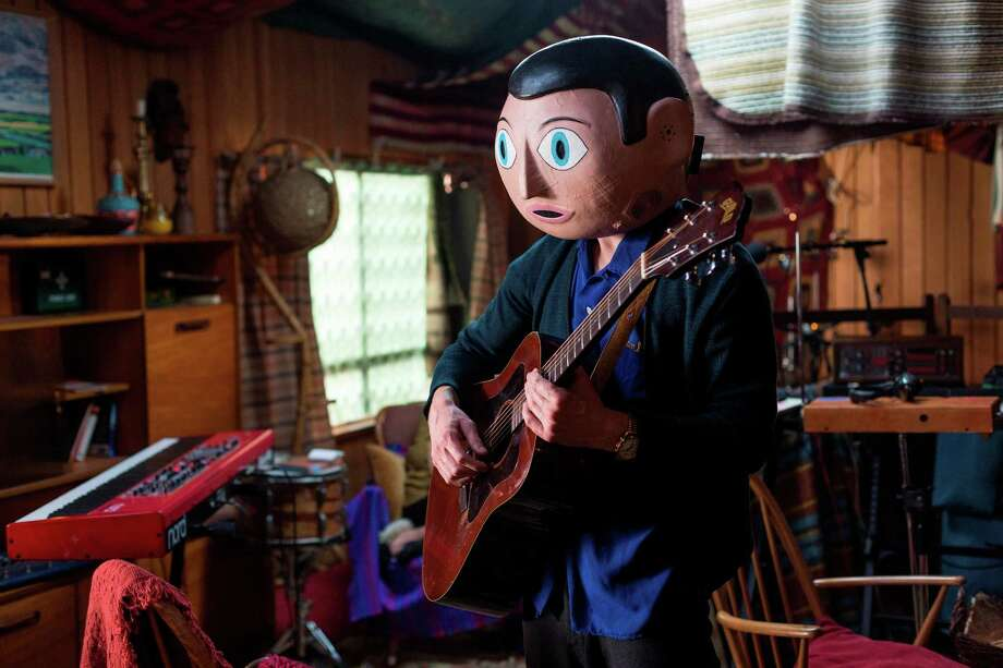 """Frank (Michael Fassbender), who has worn a papier-mâché head since he was a teen, is the leader of an avant-garde band in """"Frank."""""""