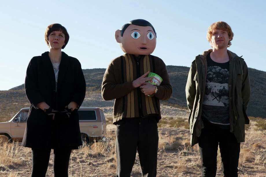 "Maggie Gyllenhaal, from left, Michael Fassbender and Domhnall Gleeson star as members of a band in ""Frank."""