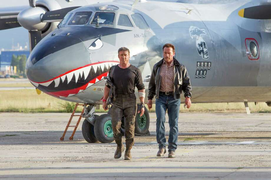 """Sylvester Stallone, left, and Arnold Schwarzenegger star in """"The Expendables 3."""" Photo: Phil Bray"""