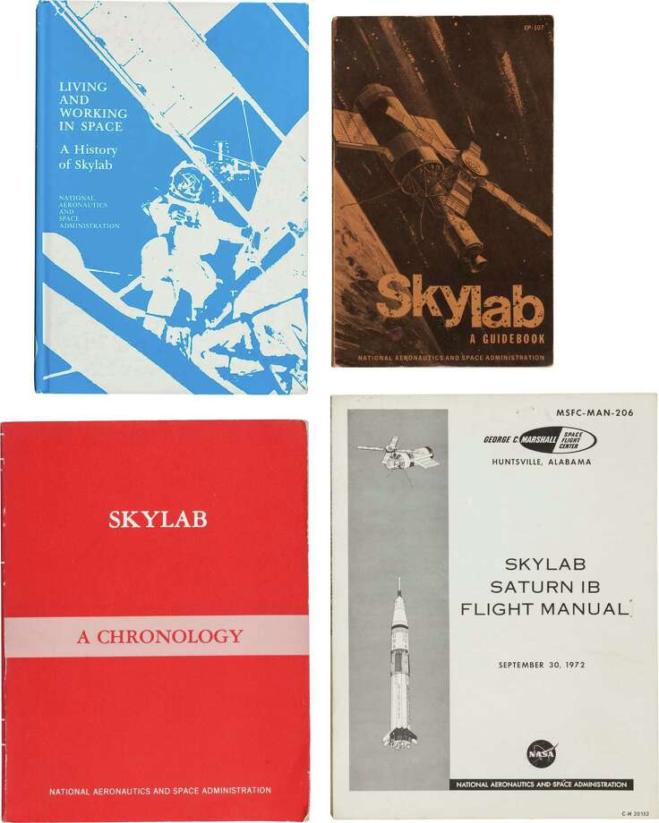 Skylab: Four NASA Publications on the Skylab Program. Including:(1) Skylab, A Guidebook by Leland F. Belew. NASA, 1973. 245 pages. Illustrated. Printed wrappers. Very good.(2) Living and Working in Space. A History of Skylab by W. David Compton and Charles D. Benson. NASA, 1983. 449 pages. Illustrated. Publisher's hardcover binding. Very good condition.(3) NASA SP-4011 Skylab a Chronology by Roland W. Newkirk and Ivan D. Ertel. NASA, 1977. 458 pages. Illustrated. Publisher's printed wrappers. Very good.
