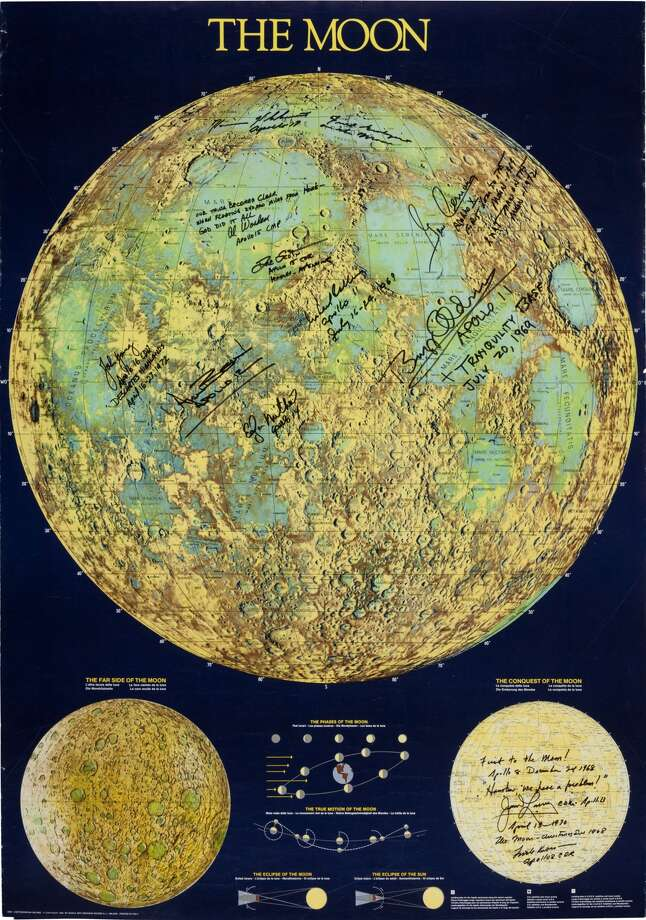"""Moon Poster Signed by Eleven Astronauts.An amazing and attractive poster map of 27"""" x 38.5"""" titled """"The Moon"""" that has been signed multiple times by men who actually flew there. Many have added additional sentiments that make this quite interesting and particularly suitable for display. Signed as follows: Buzz Aldrin: Photo: Heritage Auctions"""