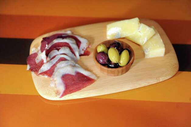 Smoking goose duck prosciutto, Dunbarton blue artisan cheese and olives on Thursday, Aug. 7, 2014, at Rare Form Brewing Company in Troy, N.Y. (Cindy Schultz / Times Union) Photo: Cindy Schultz / 00028079A