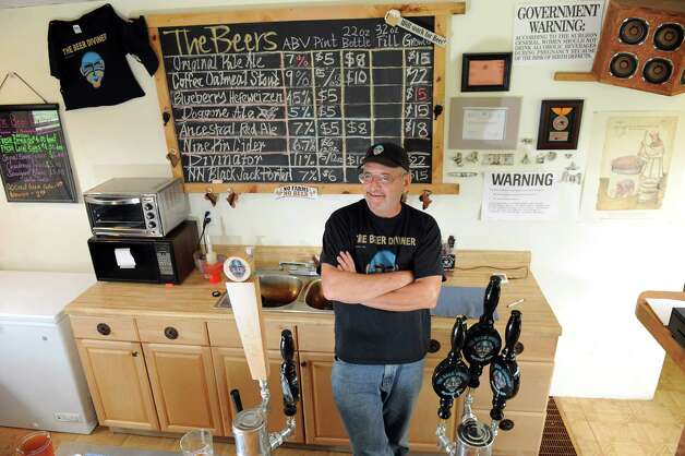 Owner Jonathan Post tends the taproom on Thursday, Aug. 7, 2014, at the Beer Diviner in Stephentown, N.Y. (Cindy Schultz / Times Union) Photo: Cindy Schultz / 00028051A