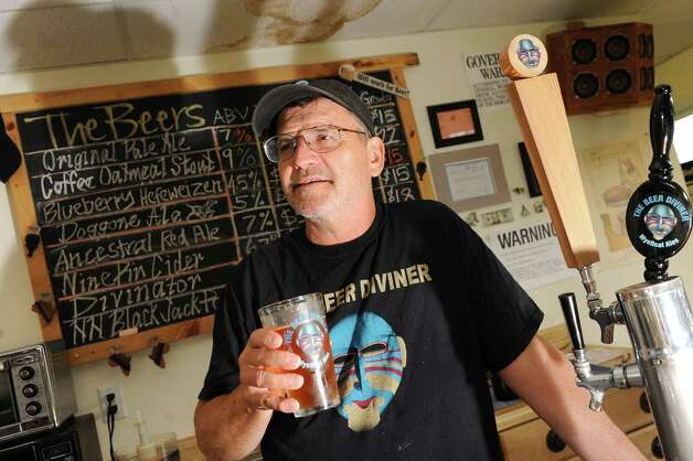 Owner Jonathan Post with a glass of his Original Pale Ale on Thursday, Aug. 7, 2014, at the Beer Diviner in Stephentown, N.Y. (Cindy Schultz / Times Union) Photo: Cindy Schultz / 00028051A