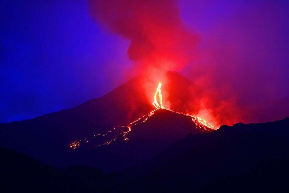 Streams of lava flowdown the slopes of Mount Etna on the southern Italian island of Sicily. Photo: Tiziana Fabi, AFP/Getty Images