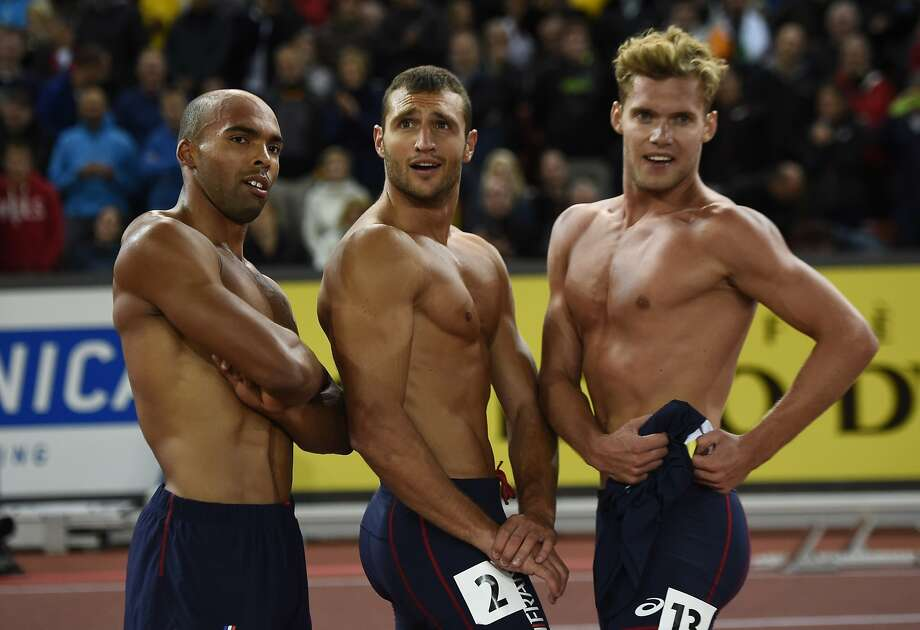 Les trois amis: France's Gael Querin (left), Florian Geffrouais and Kevin Mayer pose after 