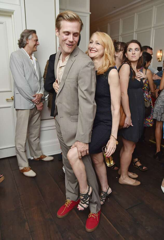 Excuse my trick knee: Zachary Booth gives fellow actor Patricia Clarkson a hand at the after-party for Sundance 
