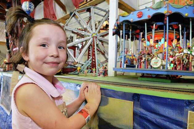 Five-year-old Megan Reis of Altamont in the circus museum at the Altamont Fair Thursday August 14, 2014, in Altamont, NY.  (John Carl D'Annibale / Times Union) Photo: John Carl D'Annibale / 00028138A