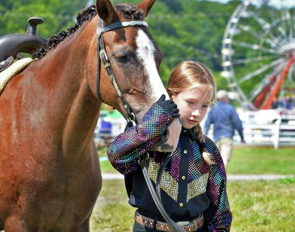 Samantha Noritsky, 9, of Altamont leads her pony Jenny back to the barns at the Altamont Fair Thursday August 14, 2014, in Altamont, NY.  (John Carl D'Annibale / Times Union) Photo: John Carl D'Annibale / 00028138A
