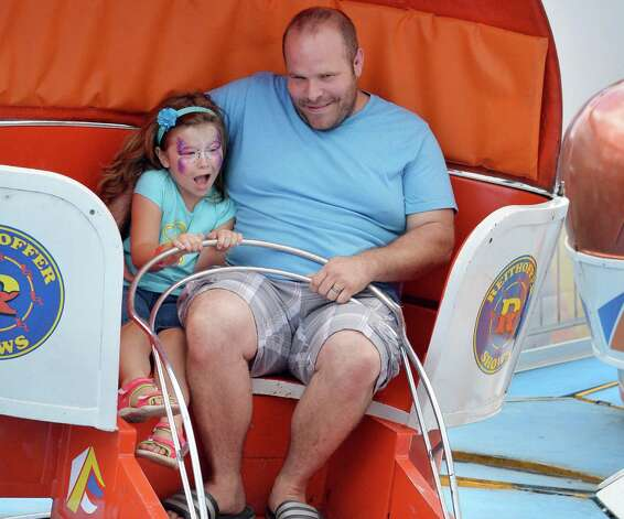 David Countermine of Scotia rides the Tilt-A-Whirl with daughter Elizabeth, 5, at the Altamont Fair Thursday August 14, 2014, in Altamont, NY.  (John Carl D'Annibale / Times Union) Photo: John Carl D'Annibale / 00028138A