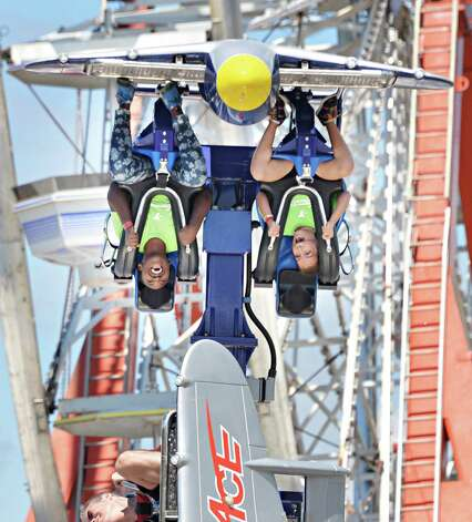 Ainasja Henry, left, 10 and Stephanie Montes, 10, both of Albany, go inverted as they ride the AirRace at the Altamont Fair Thursday August 14, 2014, in Altamont, NY.  (John Carl D'Annibale / Times Union) Photo: John Carl D'Annibale / 00028138A