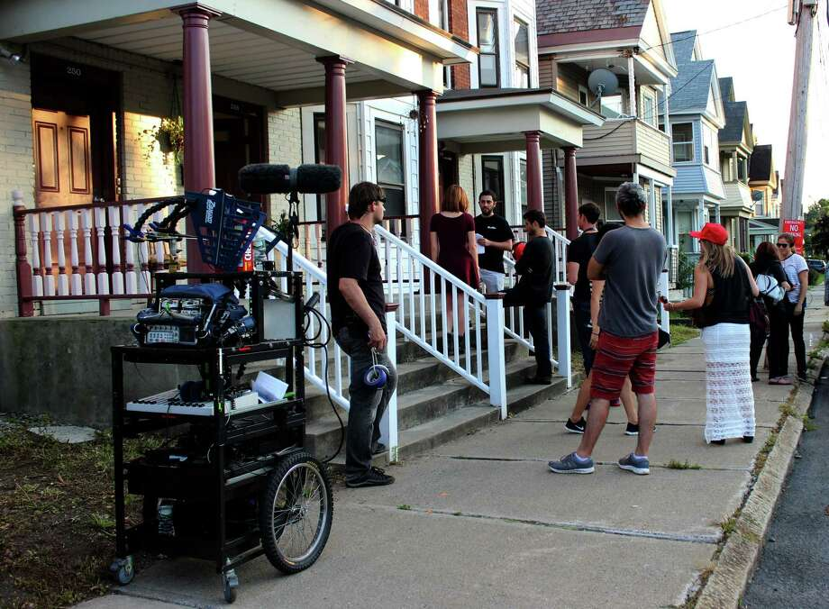 "Actors and crew film a scene for the movie ""Fourth Man Out"" while shooting Wednesday evening, Aug. 6, 2014, on Park Place in Schenectady N.Y. (Selby Smith/Special to the Times Union) Photo: Selby Smith / 00028070A"