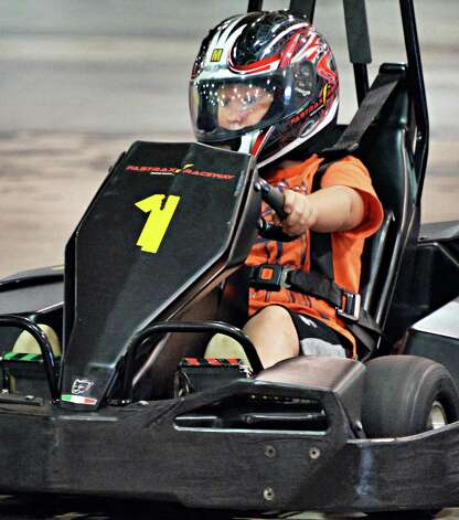 Nine-year-old Cameron Bee of Voorheesville races a go-cart at FasTrax Raceway in Crossgates Commons Tuesday July 29, 2014, in Albany, NY.  (John Carl D'Annibale / Times Union) Photo: John Carl D'Annibale / 00027899A