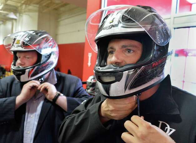 Times Union writer Steve Barnes, left, and David Zecchini don helmets as they prepare to race go-carts at FasTrax Raceway in Crossgates Commons Tuesday July 29, 2014, in Albany, NY.  (John Carl D'Annibale / Times Union) Photo: John Carl D'Annibale / 00027899A