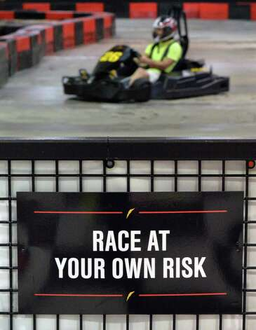 A racer drives a go-cart around the circuit at FasTrax Raceway in Crossgates Commons Tuesday July 29, 2014, in Albany, NY.  (John Carl D'Annibale / Times Union) Photo: John Carl D'Annibale / 00027899A