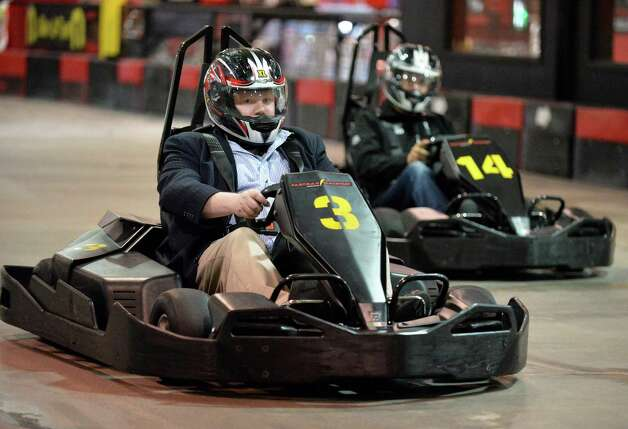 Times Union writer Steve Barnes, left, and David Zecchini race go-carts at FasTrax Raceway in Crossgates Commons Tuesday July 29, 2014, in Albany, NY.  (John Carl D'Annibale / Times Union) Photo: John Carl D'Annibale / 00027899A