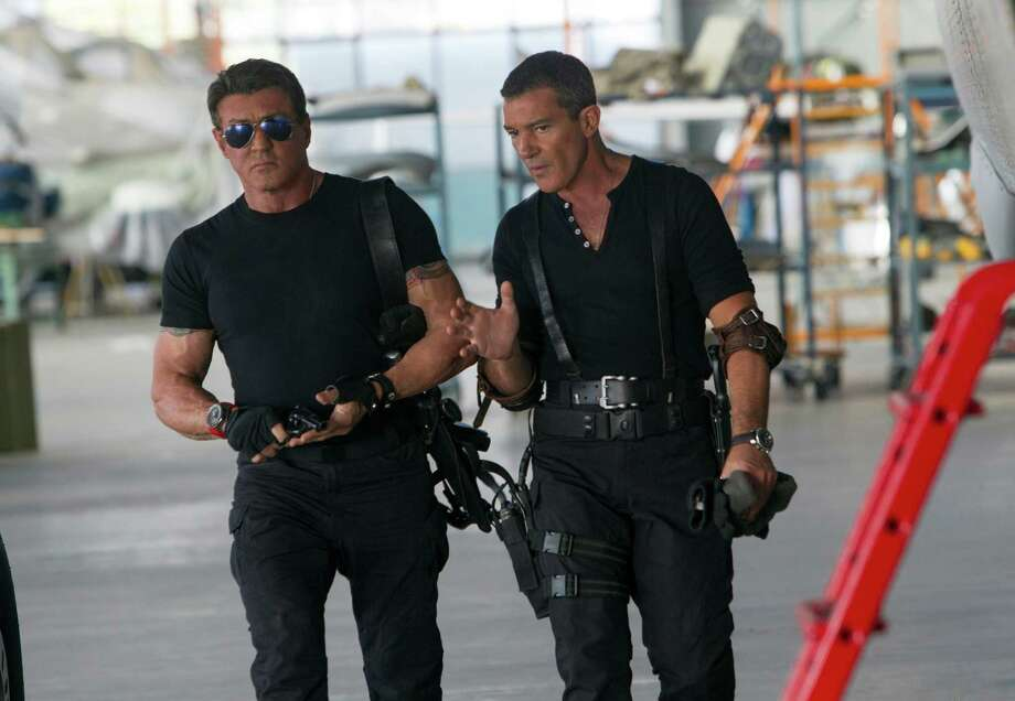 "This image released by Lionsgate shows Sylvester Stallone, left, and Antonio Banderas in a scene from ""Expendables 3."" (AP Photo/Lionsgate, Phil Bray) ORG XMIT: NYET313 Photo: Phil Bray / Lionsgate"