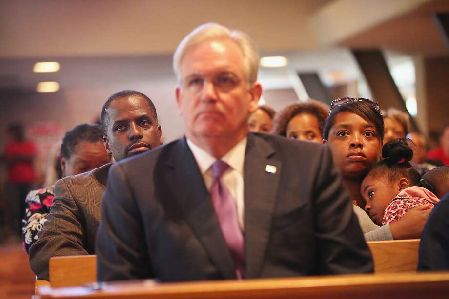 Missouri Gov. Jay Nixon listens as community members discuss the unrest in the town of Ferguson, where an unarmed teen was shot Saturday, during a forum at a church in nearby Florissant. Photo: Scott Olson, Getty Images