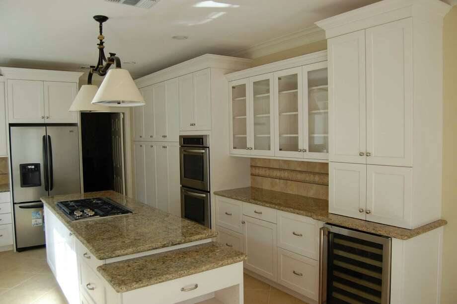 This kitchen renovation project by Lone Star Construction used cabinets supplied by Cabinets & Designs Inc.