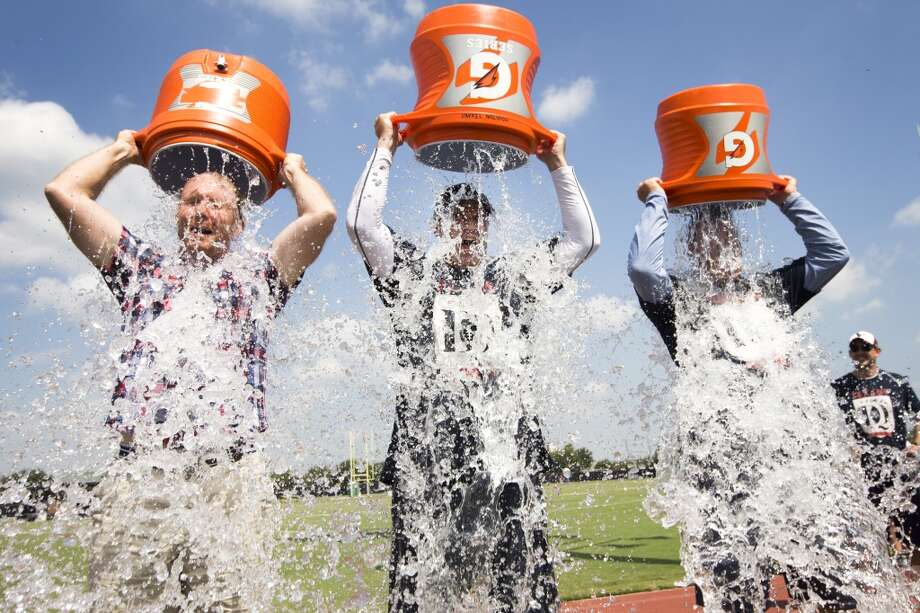 From left: Chronicle writer Brian T. Smith, Texans head coach Bill O'Brien and Texans COO Cal McNair dump ice cold water over their heads as part of the ALS Ice Bucket Challenge. The trio accepted the challenge of Chronicle writer John McClain. Photo: Brett Coomer, Houston Chronicle