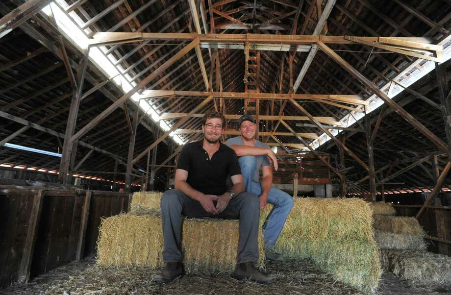 Brothers Scot and Jake Bilbro pose for a portrait inside of a barn located at one of their vineyards on August 07, 2014 in Mendocino County, CA. the Bilbro brothers are building their own empire, expanding the Marietta brand founded by their father while also launching brands of their own. Photo: Craig Hudson, Intern / The Chronicle / ONLINE_YES