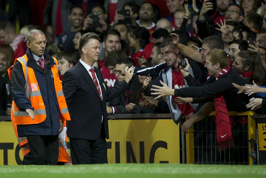 Manchester United fans hope new manager Louis van Gaal (left) is a cause for good cheers at Old Trafford. Photo: Jon Super, Associated Press