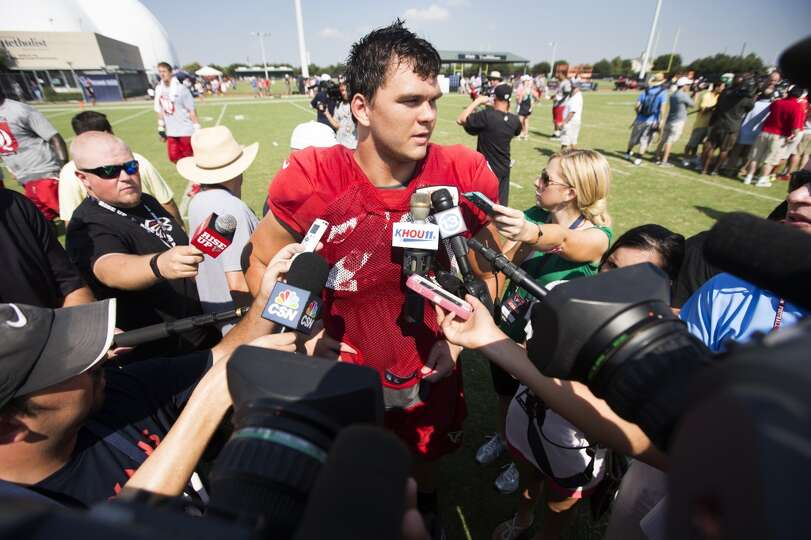 Atlanta Falcons offensive tackle Jake Matthews (70) speaks to the media following a joint practice.