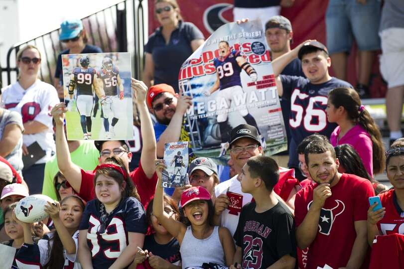 Texans fans cheer while seeking autographs.