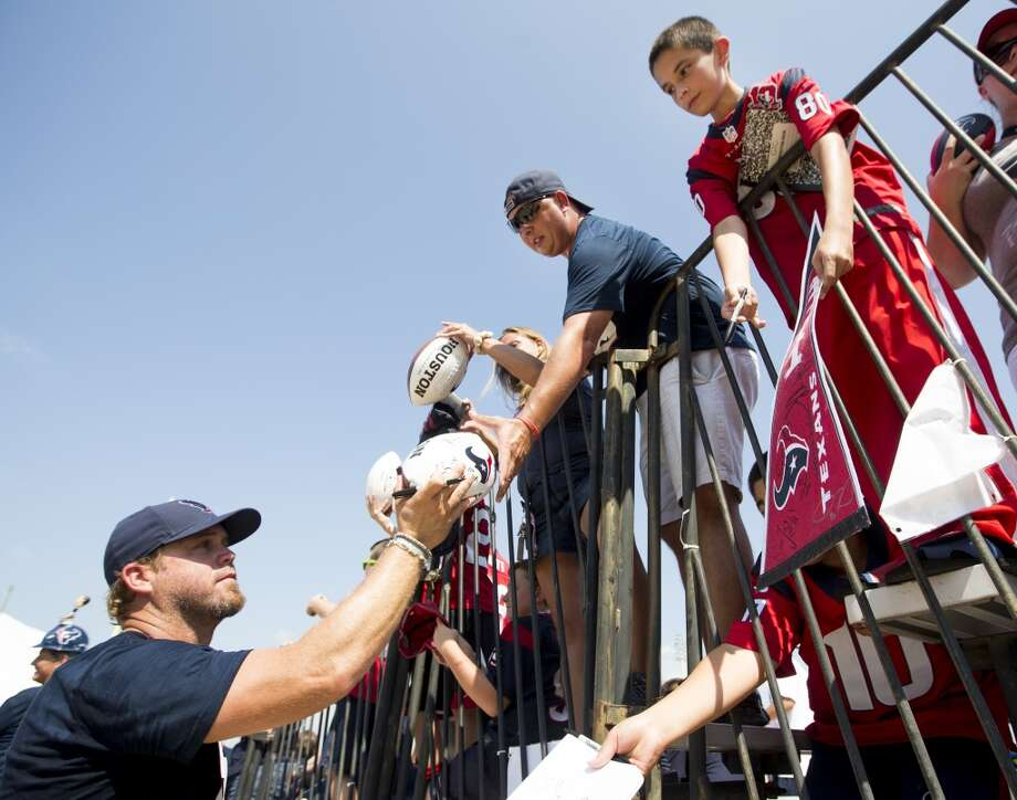 Texans punter Shane Lechler, left, signs autographs. Photo: Brett Coomer, Houston Chronicle