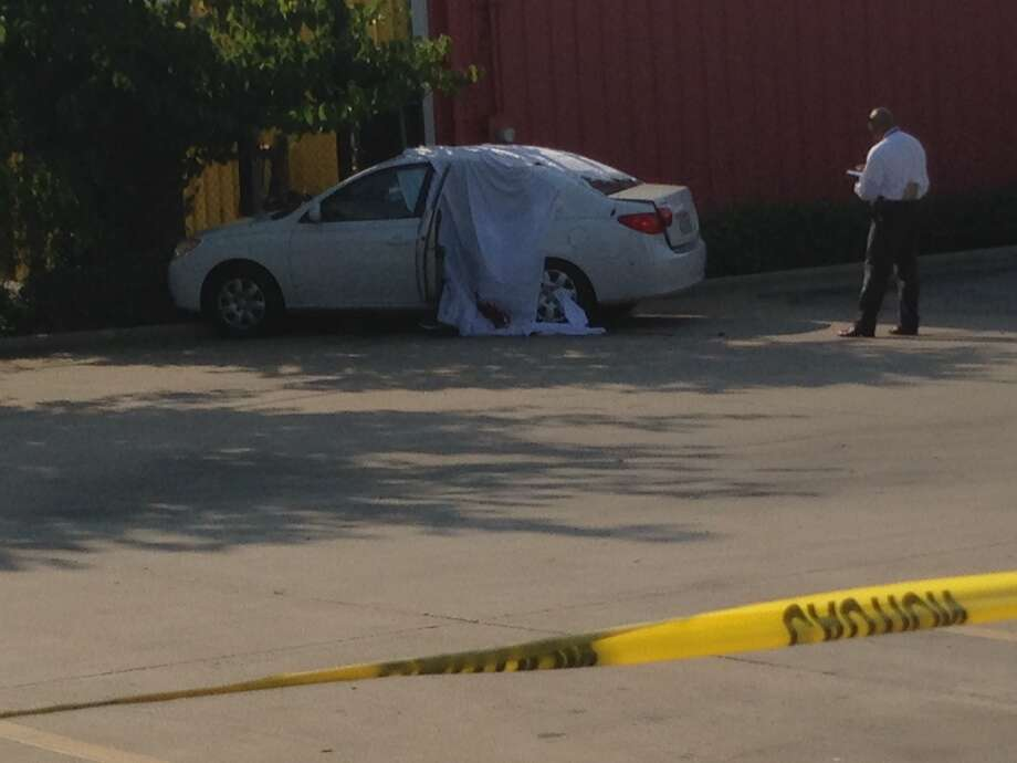 The victim's body was seen in the rear seat of a white sedan behind a Waffle House along College Avenue at Easthaven on Thursday. Photo: Mike Glenn, Chronicle