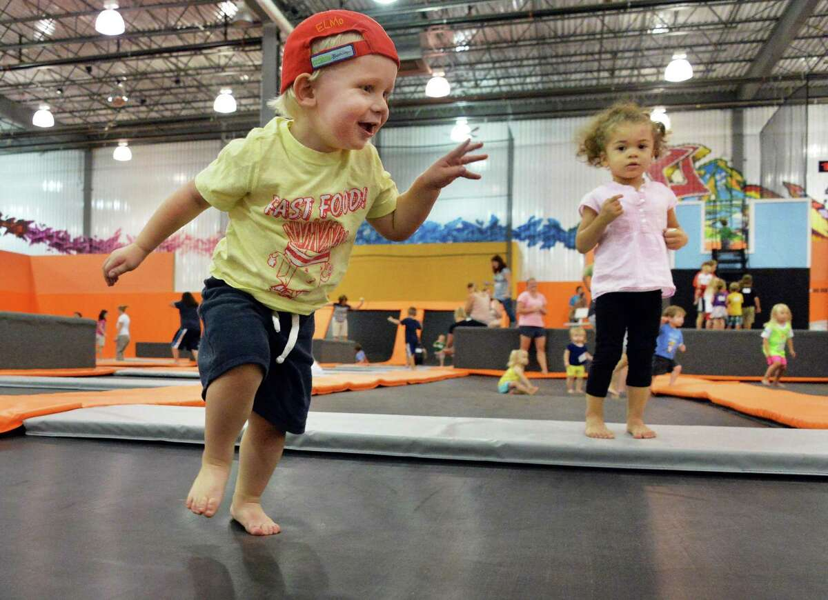 Adrian Owens, 2, left, of Niskayuna, and Isabel Ferguson, 2, of Albany, play at Flight Trampoline Park Wednesday Aug. 13, 2014, in Albany, N.Y. (John Carl D'Annibale / Times Union)