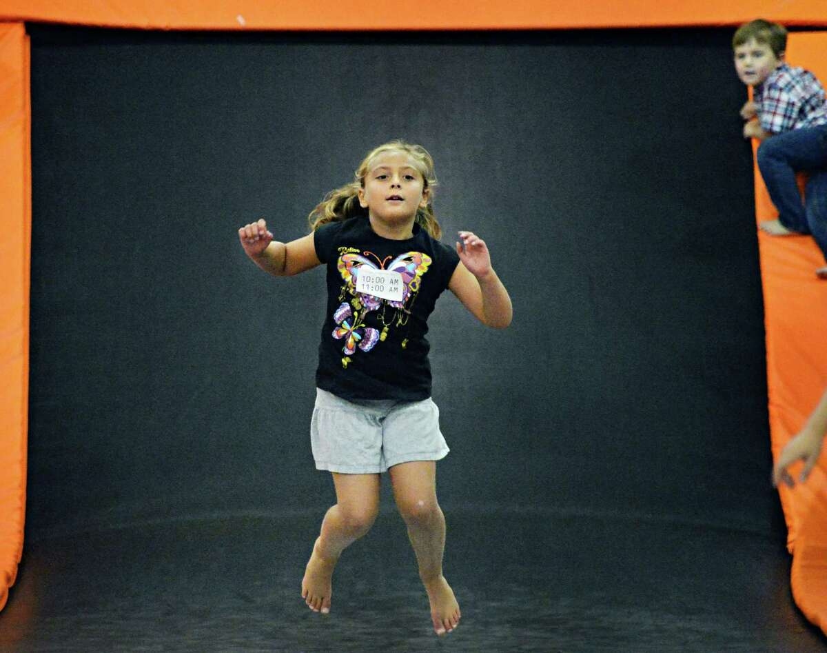 Lila Whipple, 6, of Guilderland bounces at Flight Trampoline Park Wednesday Aug. 13, 2014, in Albany, N.Y. (John Carl D'Annibale / Times Union)