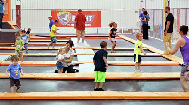 Parents and children enjoy the facilities at Flight Trampoline Park Wednesday Aug. 13, 2014, in Albany, N.Y.  (John Carl D'Annibale / Times Union) Photo: John Carl D'Annibale / 00028101A