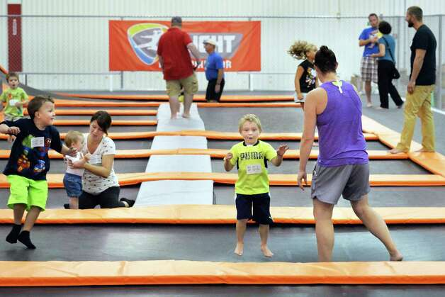 Three-year-old Luke Perrotta, center, of Waterford bounces with other children and parents at Flight Trampoline Park Wednesday, Aug. 13, 2014, in Albany, N.Y.  (John Carl D'Annibale / Times Union) Photo: John Carl D'Annibale / 00028101A