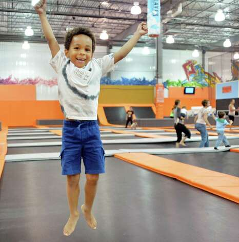 Five-year-old Jude Cator of Albany catches some air at Flight Trampoline Park Wednesday, Aug. 13, 2014, in Albany, N.Y.  (John Carl D'Annibale / Times Union) Photo: John Carl D'Annibale / 00028101A