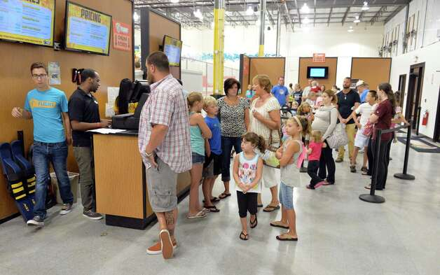 Parents and children queue up as Flight Trampoline Park opens Wednesday morning, Aug. 13, 2014, in Albany, N.Y.  (John Carl D'Annibale / Times Union) Photo: John Carl D'Annibale / 00028101A