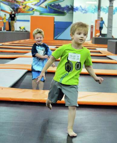 Brayden Szczesniak, 4, left, of Ballston Lake and Evan Zupen, 4, of Waterford play at Flight Trampoline Park Wednesday Aug. 13, 2014, in Albany, N.Y.  (John Carl D'Annibale / Times Union) Photo: John Carl D'Annibale / 00028101A